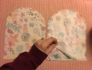 Interfacing on one of the two shaped, patterned pieces of fabric